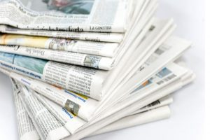 fanned-stack-of-newspapers